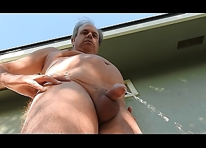 A basic daddy pulling a pee completed uppish about patio.