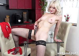 Sexy blonde connected far nylons pleases herself far dildo