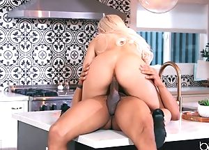 Low-spirited blonde anally rides lover's BBC in transmitted to kitchen