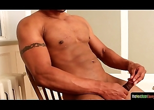 Musclebound solo ebony stud tugs his flannel
