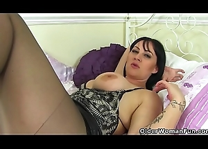 British milf Amber Leigh fucks herself with a fake penis